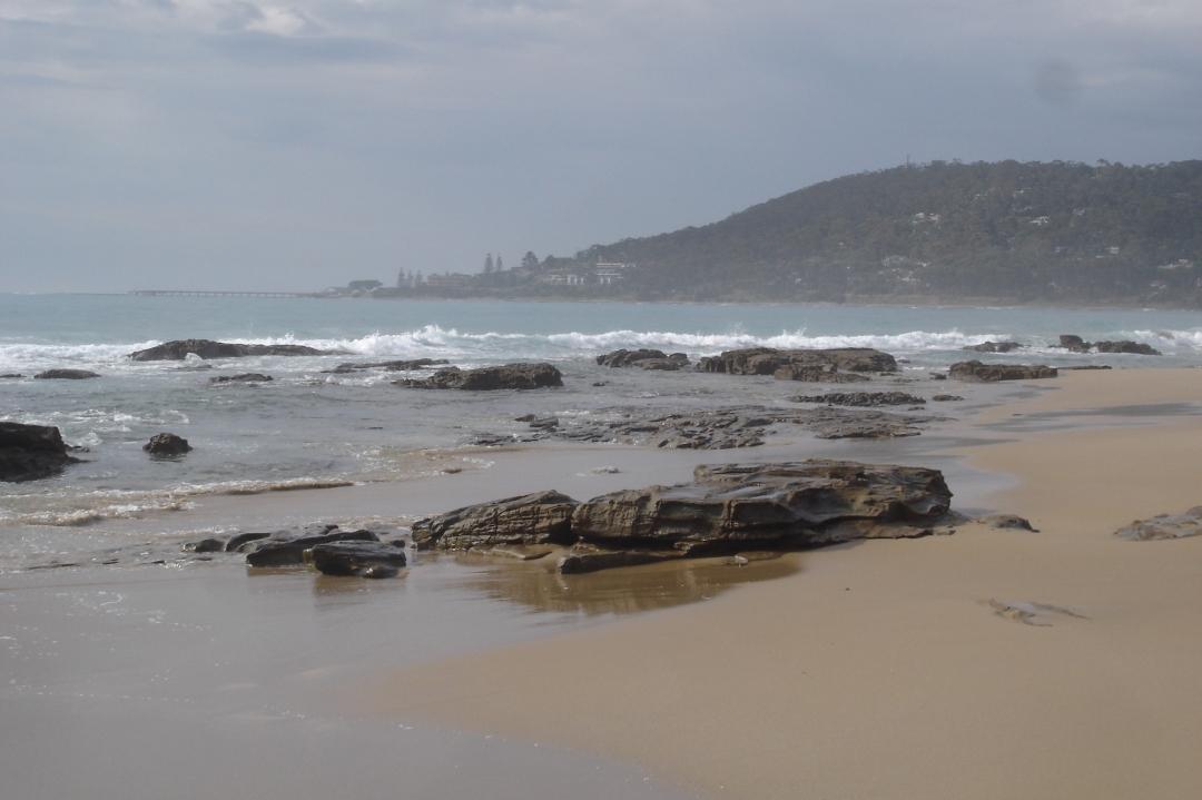 beach with rocky outcrop